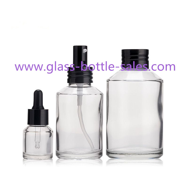 Clear Sloping Shoulder Glass Lotion Bottles With Droppers Caps Pumps